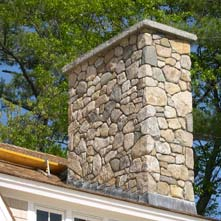 Large fieldstone chimney with 6� thick granite cap