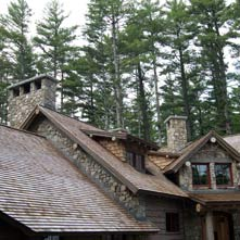Two beautiful fieldstone chimneys with raised 6� thick granite caps on an Adirondack style home.