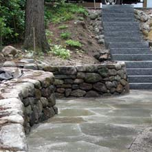 Bluestone patio, fieldstone retaining wall and granite steps