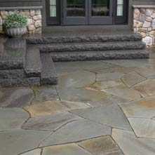 Large irregular shaped bluestone patio set in stone dust, with Caledonia granite steps