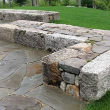 Artistically and beautifully crafted antique granite and New England fieldstone wall designed by Chad P. Sanborn