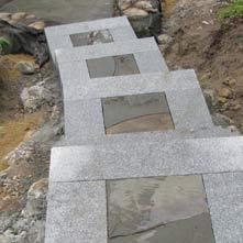 Step landings done in mosaic inlayed bluestone surrounded by granite