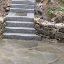 Granite steps with landings in mosaic inlayed bluestone surrounded by granite