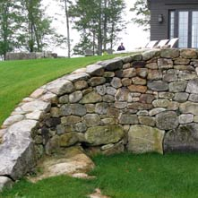 Large curved fieldstone retaining wall