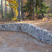 Beautifully curved fieldstone retaining wall in historic district