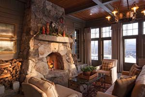 Rustic fireplace in three-season porch crafted by Chad Sanborn of Stone Age Design